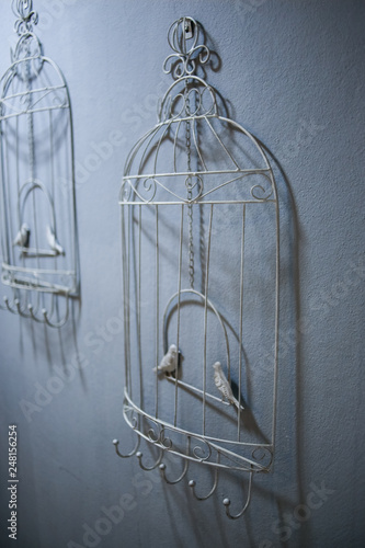 Fotografie, Obraz  Decoration on the wall in the form of a bird cage