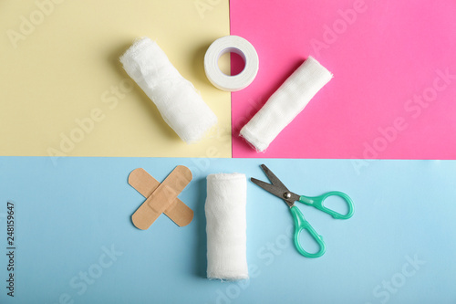 Items from first aid kit on color background Canvas Print