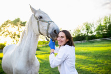 Vet Enjoying With A Horse Outd...