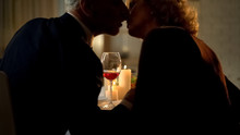 Senior Man And Woman Kissing During Romantic Date, Married Couple Affection
