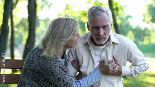 Healthcare, pensioner suffering from strong chest pain, heart attack risk Fotobehang