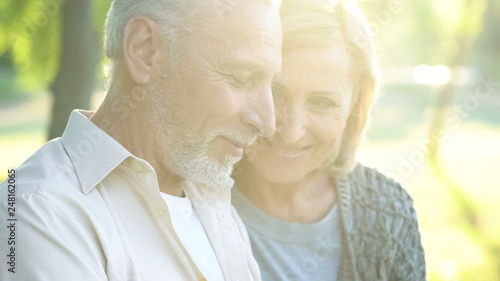 Fotografia  Beautiful woman in his 60s tenderly looking at retired male, happy aged couple
