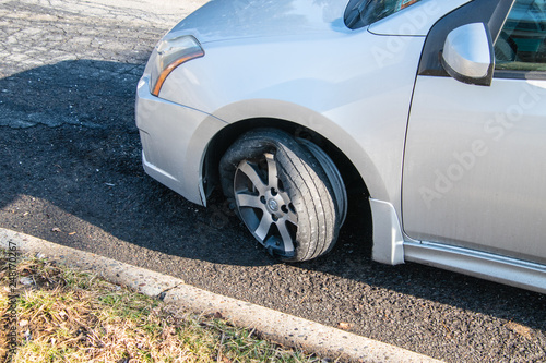 Car tire that has a blowout with rim and car damage Tablou Canvas