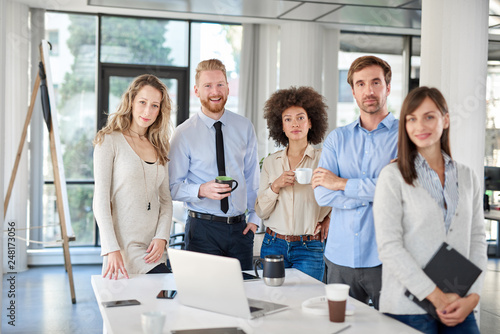 Fotografie, Obraz  Small group of business people standing and posing at office