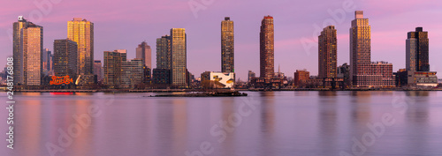 Long Island City panoramic view from east river at sunset with long exposure