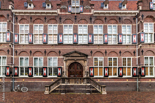 Flemish architecture school brick facade with a bicycle parking in front, Amster Canvas Print