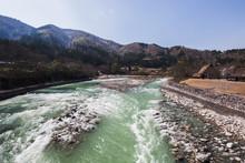 Rushing Blue River Stream In The Alps Of Shirakawa-go Japan