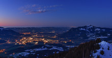 City Night Lights Of Sonthofen (Allgaeu, Bavaria, Germany) After Sunset With Gruenten Mountain In Winter. Landscape In Twilight With Blue Sky And Some Clouds.