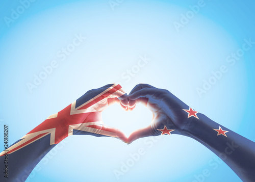 New Zealand flag pattern on people hands in heart shaped isolated on blue sky  for NZ national public holiday celebration Canvas Print