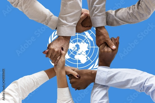 Obraz united nations flag, intergration of a multicultural group of young people - fototapety do salonu