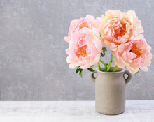 Bouquet Of Pink Peonies On Grey Stone Background