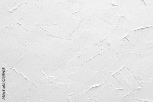 Fototapeta White textured wall. Decorative plastering close-up photo. Surface with stucco daub obraz