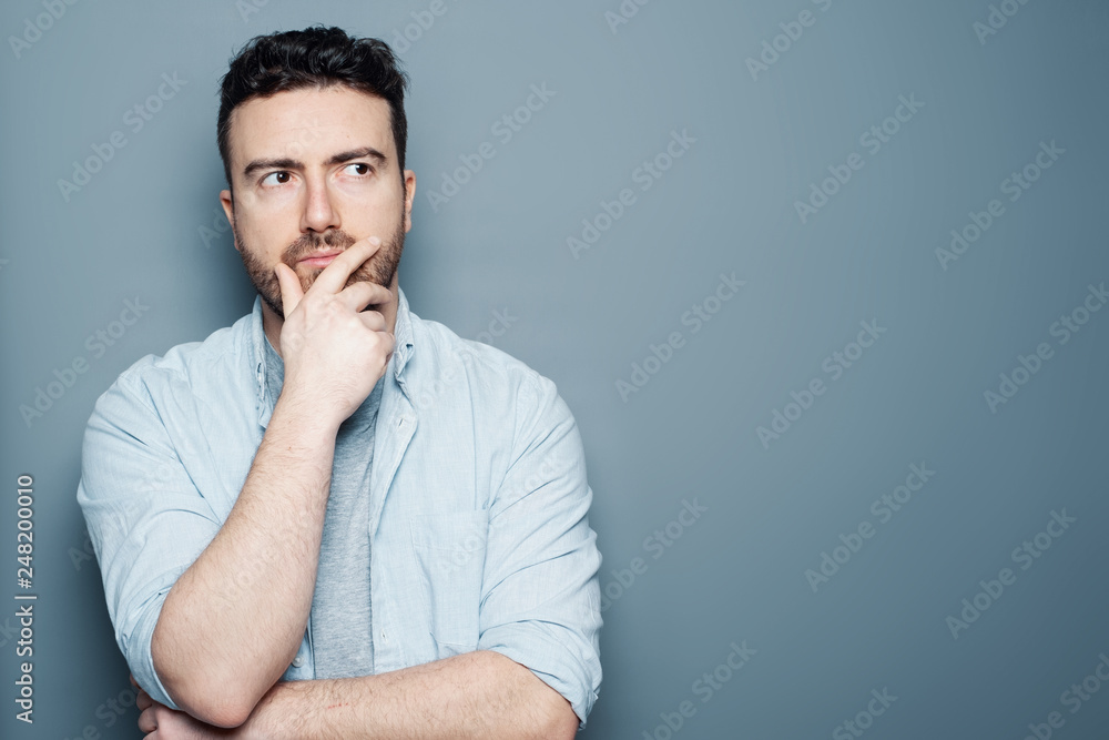 Fototapety, obrazy: Thoughtful man portrait isolated on background