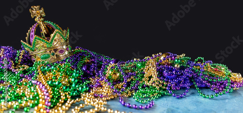New Orleans mardi gras crown and beads in green, gold, and purple Canvas Print