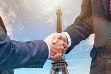 Handshake Agreement Of Businessman With Partnership On Eiffel Tower