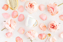 Stylish Cup Of Coffee, Leaf Golden Plate And Spoon With Pink Roses Flowers And Petals. Flatlay, Top View On Pastel Concrete Background