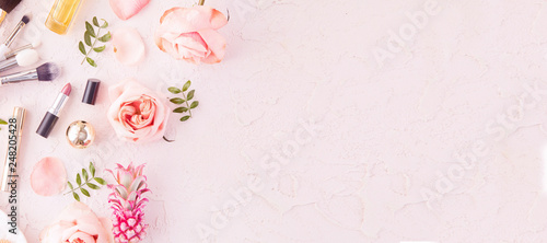 Obraz Makeup products and make-up brush with pink flowers on pastel background. Panoramic banner with copy space for text. Luxury beauty. - fototapety do salonu