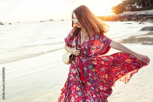 Foto Beautiful girl in boho maxi dress on the beach