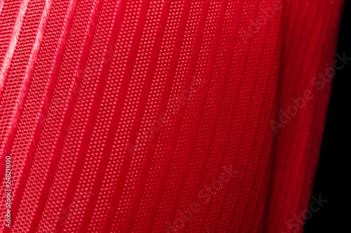 red fabric with stripes as a background