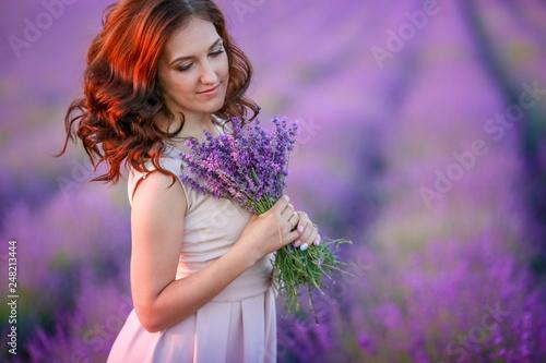 Fotografie, Obraz  beautiful bride in luxurious wedding dress in purple lavender flowers