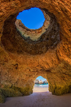 Famous Caves In A Beach Rock F...