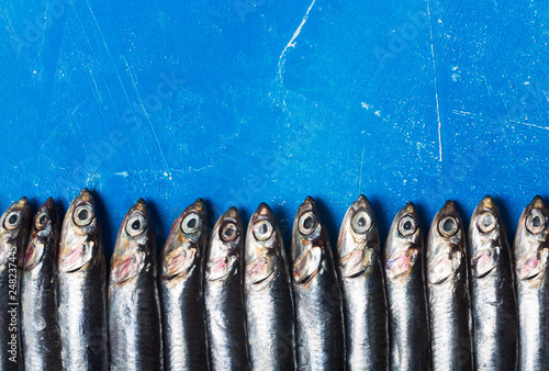 Photo Seafood. Small sea fish, anchovies. Top view, fish pattern
