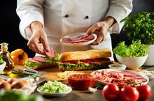 Chef Preparing A Crusty Baguette Sandwich