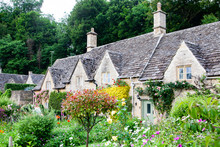 Traditional Cotswold Cottages In England, UK. Bibury Is A Village And Civil Parish In Gloucestershire, England