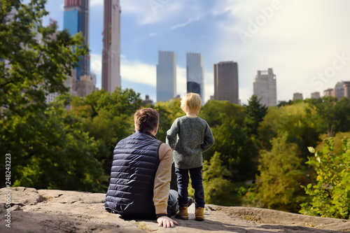 Man and his charming little son admire the views in Central Park, new York Wallpaper Mural