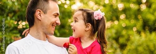 Valokuva  Portrait of little girl hugging her daddy
