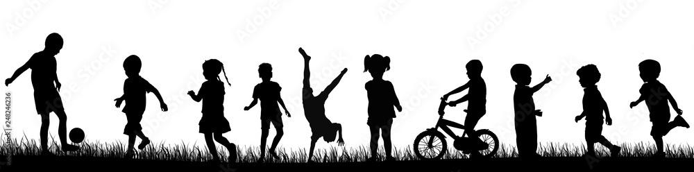 Fototapeta Children silhouette playing in the park