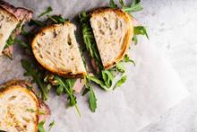 Overhead Image Of Roast Beef Sandwich With Rugula And Mustard