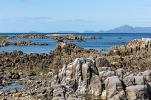 View From A Rocky Mangawhai Beach At The Low Tide  A Pair Of Cormorants Resting On The Boulders.