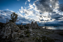 Dusk Sunset At Mono Lake, With Sunbeams Poking Through The Clouds