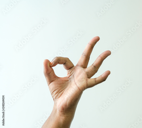 Valokuva  Hands with fingers making the OK sign
