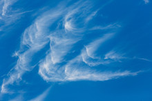 Wispy Hook Shaped Clouds Over ...