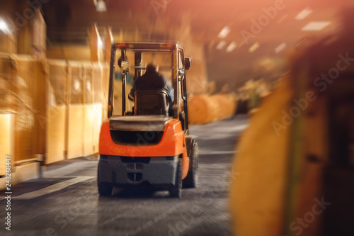 Fotografie, Obraz  Warehouse industrial premises for storing materials and wood, forklift containers