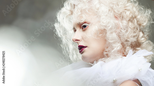 Fotografie, Obraz  Young attractive woman with platinum blonde and purple lipstick