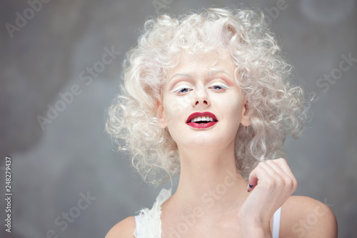 Young attractive woman with platinum blonde and purple lipstick Wallpaper Mural