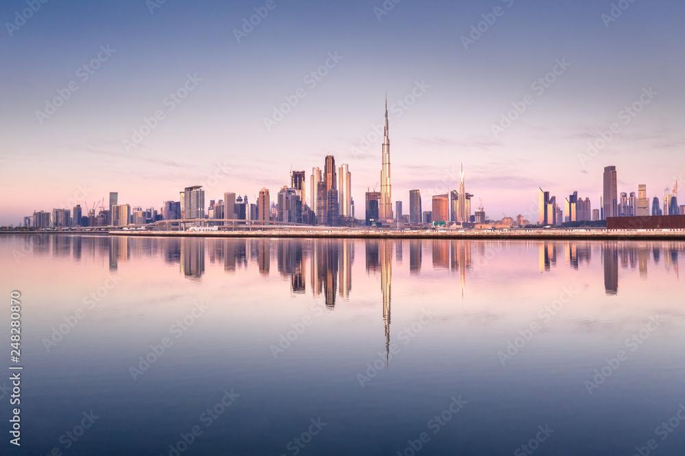 Fototapety, obrazy: Beautiful colorful sunrise lighting up the skyline and the reflection of Dubai Downtown. Dubai, United Arab Emirates.