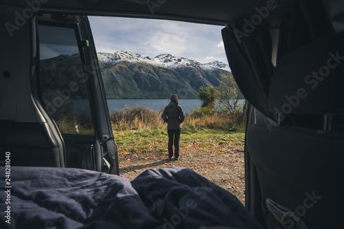 Spoed Foto op Canvas Grijze traf. Woman admiring the landscape view beside the lake