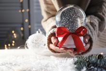 Woman Holding Christmas Snow G...