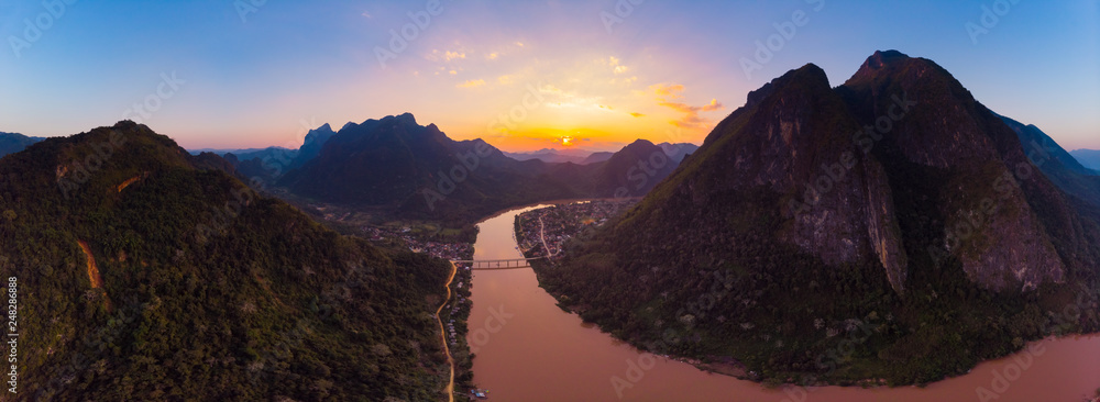 Fototapety, obrazy: Aerial panoramic Nam Ou River Nong Khiaw Muang Ngoi Laos, sunset dramatic sky, scenic mountain landscape, famous travel destination in South East Asia