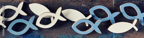 Set of cut out Christian religion fish symbols Fototapete