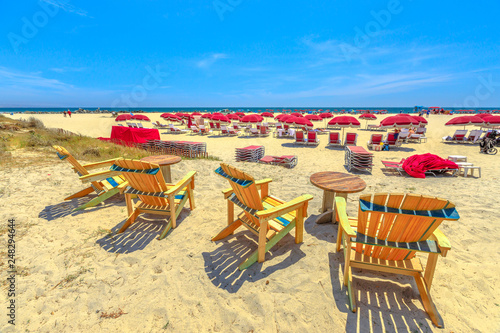 Sea chairs in Coronado Beach along Ocean Boulevard on Pacific Ocean, Coronado Island, San Diego. Summer season in West Coast, USA. Blue sky with copy space. Summer holidays in California.