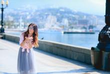 Girl Walking Along The Seafron...