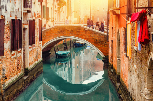 Türaufkleber Gondeln Old canal with boats and bridge in Venice, Italy. Street with old Italian architecture of Venice. Cityscape of Venice at sunset.