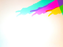 Colorful Shadows Of An Arm On White Background