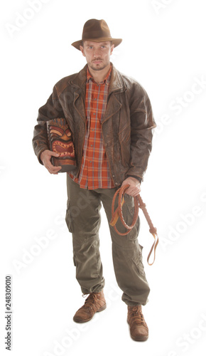 Fotografia Adventurer explorer is holding whip and ancient wooden idol