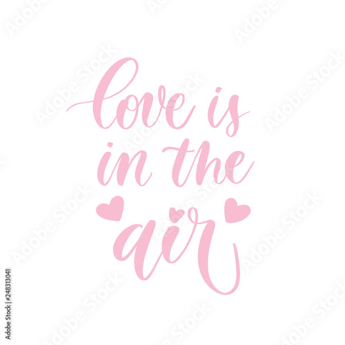 Photo  Love is in the air -  pink hand lettering card  with hearts